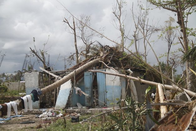 Experts say artificial intelligence (AI) and big data are critical to combat climate change. One project uses AI to visualise the consequences of a changing climate by 'bringing the future closer.' It visually projects how houses and streets will look following the impact of climate related events. A file photo of Haiti shows impact on the country after Hurricane Matthew in October 2016. Credit: Kenton X. Chance/IPS