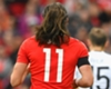 Gareth Bale's hair misbehaves in a World Cup qualifying match between Wales and Georgia