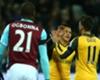Alexis Sanchez and Mesut Ozil celebrate against West Ham
