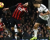 Aleksandar Mitrovic (R) misses a header against Huddersfield Town
