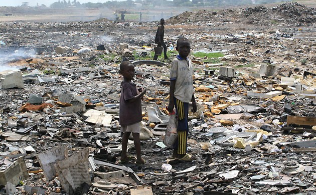 Children forage in e-waste dump