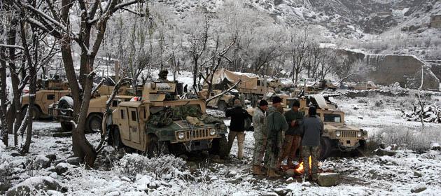 Photographer John D McHugh in Afghanistan