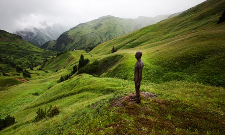 Antony Gormley iron man figure near Lech