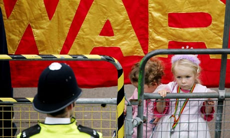 A policeman and two children at an anti-war protest