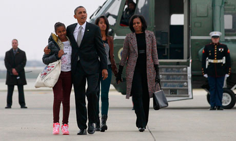 President Barack Obama, first lady Michelle Obama, right, and their daughters Malia and Sasha, left.