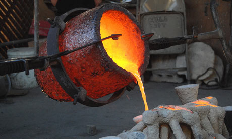 Molten bronze is poured into a mould created using the lost wax process