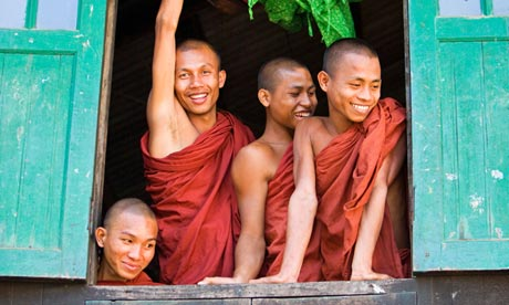 Novice monks look out of their dormitory window at the Pathain Monastery in Burma