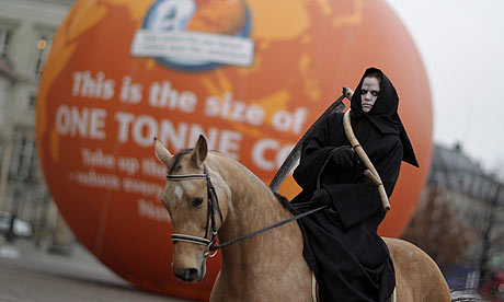 A climate activist dressed as a horseman of the Apocalypse