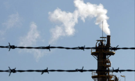 Australia carbon emission :  factory chimney at an industrial park in Sydney