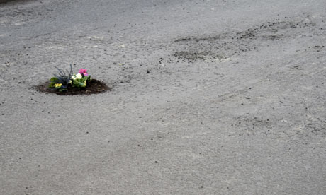 One  of Pete Dungey's pothole flower installations