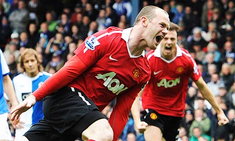 Manchester United's Wayne Rooney celebrates his penalty against Blackburn Rovers