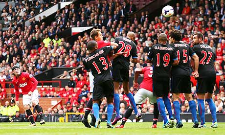 Manchester United's Wayne Rooney, left, scores his side's second goal against 10-man Crystal Palace