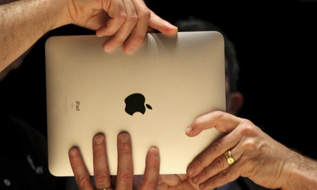 Members of the technology media try out Apple's