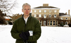 Julian Assange talks to reporters at Ellingham Hall, home of Frontline Club founder Vaughan Smith