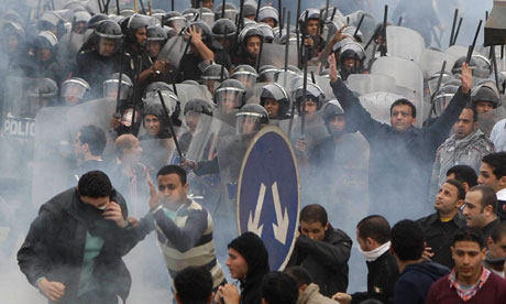 Anti-government protestors clash with riot police in Cairo