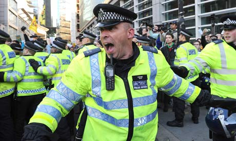 Police at the student protest over university tuition fees in London on 9 November