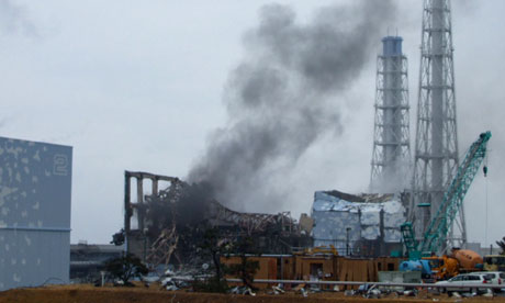 Disaster stricken Fukushima nuclear plant with smoke rising