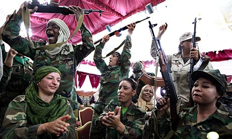 Female Libyan supporters of Gaddai celebrate after graduation in weapons training