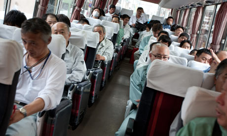 Workers on the bus which will transfer them to the Fukushima Daiichi nuclear plant