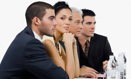 Businessmen and businesswomen in meeting