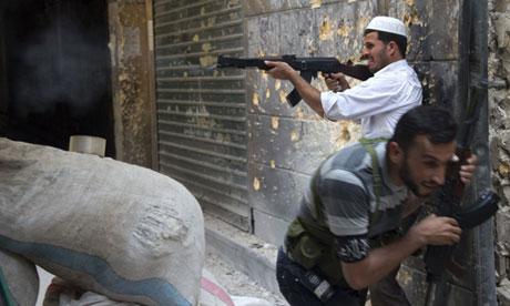 A Syrian rebel fires towards regime forces in Aleppo