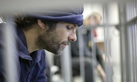 Iain Rogers, Greenpeace activist, in a cage in court