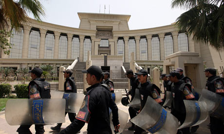 Egyptian security forces with riot shields outside the supreme constitutional court in Cairo