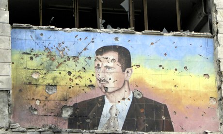A picture of Bashar al-Assad riddled with holes
