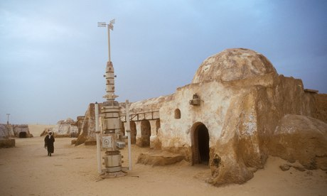 Arab man walking in the remains of the Star Wars set now a tourist attraction in the Tunisian desert