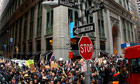 Day of action sees dozens of Occupy protesters arrested - video