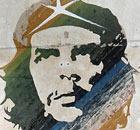 Cuban near Che Guevara mural