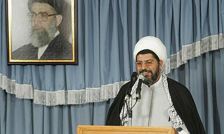 Ali Shirazi, an aide to Supreme Leader Ayatollah Ali Khamenei, speaks under a picture of the supreme leader in Tehran