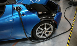A power cable is plugged into a Tesla Roadster after a news conference with California governor Arnold Schwarzenegger at Tesla Motors in San Carlos, California