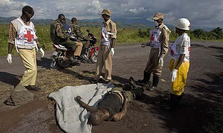 Red Cross staff remove a body in Congo