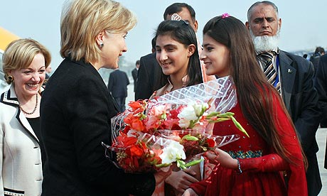 Hillary Clinton receives flowers upon her arrival in Pakistan for a three-day visit.