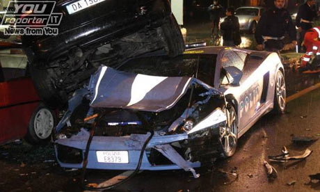 An Italian police Lamborghini Gallardo that crashed into parked cars