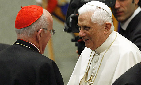 The pope greets Cardinal Sean Brady of Ireland