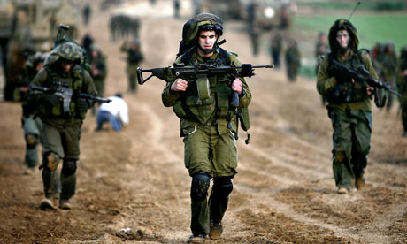 Israeli soldiers cross back into Israel in the early morning after an offensive in the Gaza Strip in January. Photograph: Jerry Lampen/Reuters (Source: The Guardian)
