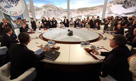 World leaders from the G8 group of nations attend a round-table discussion in L'Aquila, Italy.