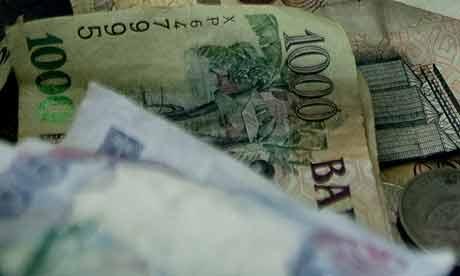 A pile of Ugandan shillings