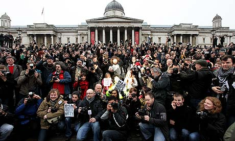 Photographers protest in Trafalgar Square against the use of anti-terror stop and search powers