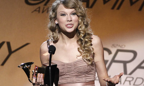 Singer Swift speaks onstage with her award for best female country vocal performance