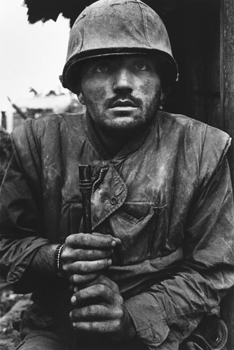 Hue, Vietnam, February 1968: A US marine suffering severe shell shock waits to be evacuated from the battle zone