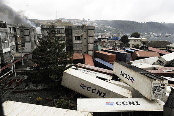 Tsunami damage: Containers are scattered amid buildings after a tsunami in Chile