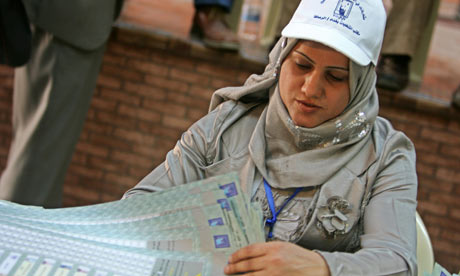 A Baghdad electoral worker counts ballots in Iraqi elections March 2010