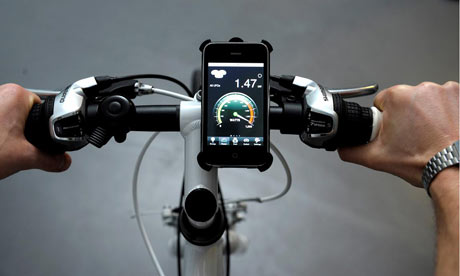 An iPhone attached to the handlebars shows how much power is being fed into the hotels system