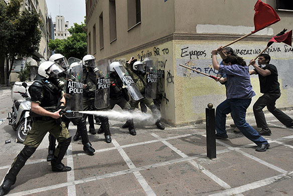 Strike in Greece: Riot police spray tear gas and clash with protestors