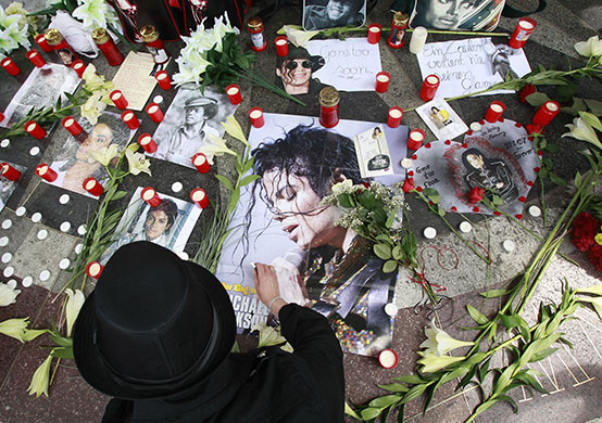Michael Jackson memorial: A Michael Jackson fan lights candles to 