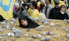 An Iranian woman at a protest in Brussels highlights the barbarity of death by stoning