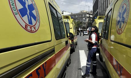 Ambulance crews join doctors and health workers to protest against cuts outside the Greek parliament